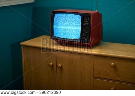 No signal just noise on old analogue TV set in the dark