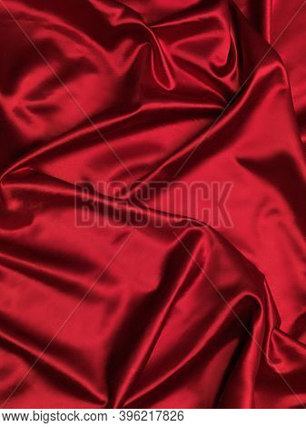 Red shiny silky satin fabric background texture