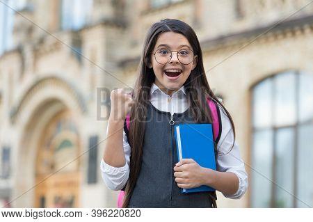 Scholarship Winner. Happy Child Make Winning Gesture Outdoors. Scholarship Student. School Education