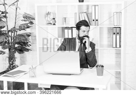 Business Thinking. Serious Businessman Sit At Office Desk. Bearded Men Think Over Serious Business.