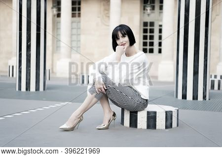 Urban Fashion Concept. Girl Fashionable Lady With Bob Hairstyle Outdoor Urban Architecture Backgroun