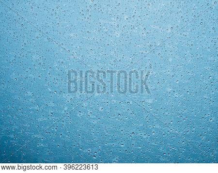 Closeup Raindrops On Glass Car In The Rainy Season.