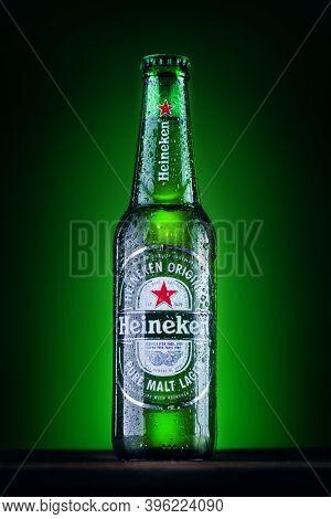 Orhei, Moldova - June 4, 2020 : Bottle of Heineken Lager Beer on green background. Heineken is the flagship product of Heineken International