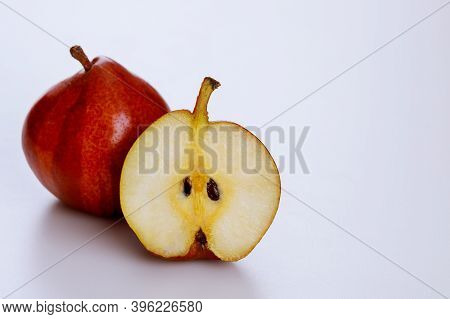 Red Organic Pears Isolated On White Background. Produce Product.