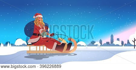 Girl In Santa Claus Costume Riding Sledge Happy New Year Merry Christmas Holidays Celebration Concep