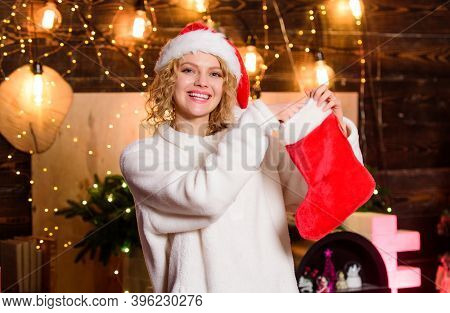 Woman Hold Red Stocking. New Year Celebration. Stockings Filled With Many Fun Things, Called Christm