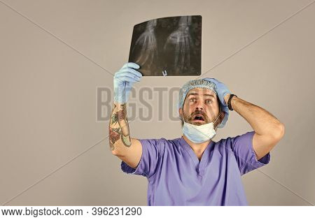 Doctor Examines Radiographic Snapshot Of Wrist. Surgeon Estimate Damages. Hospital Emergency. Doctor