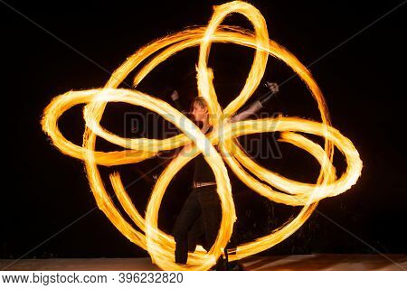 Make Your Event Extraordinary. Sensual Girl Perform Infinite Spirals In Darkness. Burning Poi Spinni