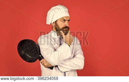 Recipe. Hold Frying Pan. Best Quality. Bearded Cook In Uniform With Tools. Bearded Man Hold Cooking