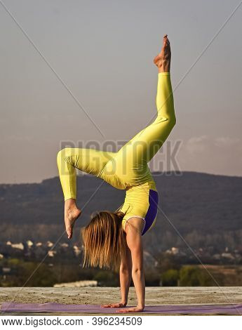 You Just Get Strong. Flexible Girl Outdoor. Woman Practicing Yoga. Stretching Muscles. Fitness Train