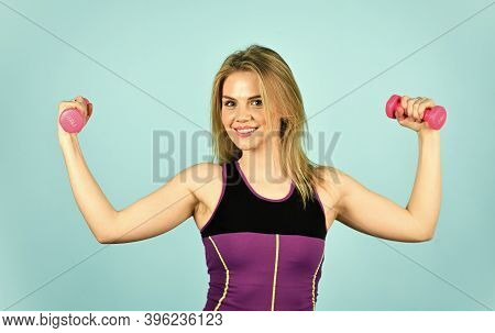 Great Progress. Slim Girl Doing Triceps Exercise With Dumbbell In The Gym. Coach Dressed In Sport Cl