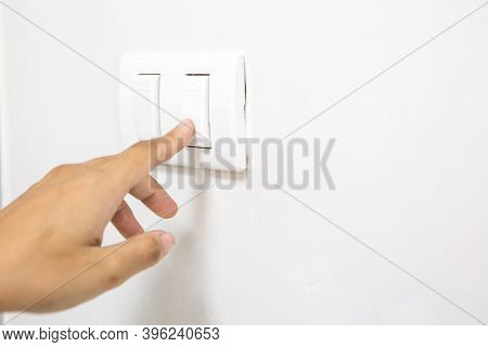 A Woman's Finger Is Pressing A Switch And Copy Space