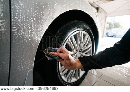 Car Wheels Cleaning With Special Stains And Oil Removing Detergent.