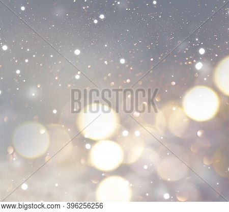 Christmas glowing Background. New year abstract glittering blurred backdrop with blinking stars and sparks. Xmas Bokeh.