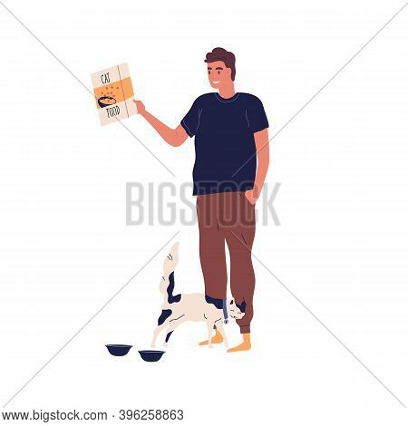 Young Guy Going To Fill Bowl For Feeding Hungry Cat. Man Holding Package With Pet Food. Kitten Excit