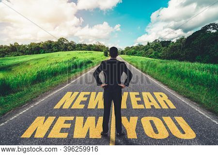 The 2021 New Year Journey And Future Vision Concept . Businessman Traveling On Highway Road Leading