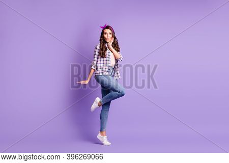 Full Length Profile Photo Of Lady Arm Cheekbone Stand Tiptoe Wear Plaid Shirt Headband Jeans Footwea