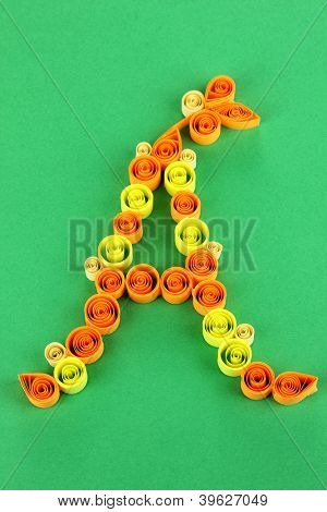 The letter A is made of quilling on green background poster