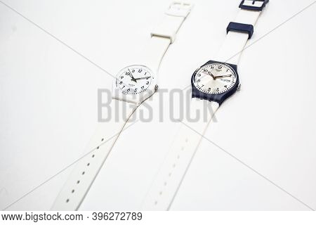 London, Gb 07.10.2020 - Two Swatch Swiss Made Quartz Watch Isolated On White Background. Black And W