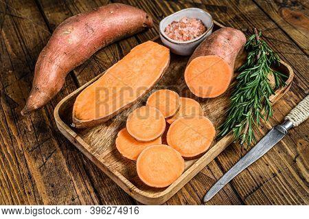 Raw Cut Yam Sweet Potato. Wooden Background. Top View