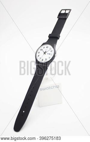 Geneve, Switzerland 07.10.2020 - Swatch Cheapest Trendy Swiss Made Plastic Watch On Stand, Simple Bl