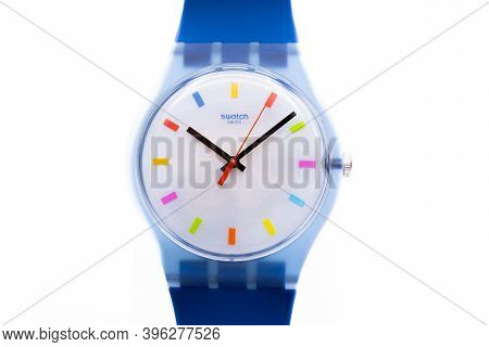 Rome, Italy 07.10.2020 - Swatch Childrens Cheapest Trendy Swiss Made Quartz Watch Close Up. Blue Pla