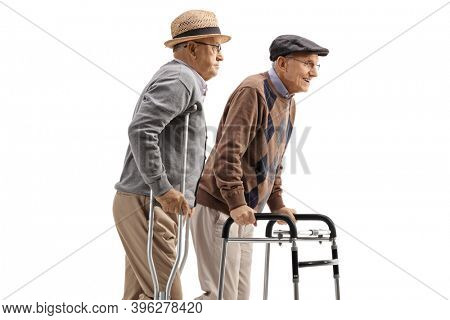 Elderly men walking with crutches and a walker isolated on white background