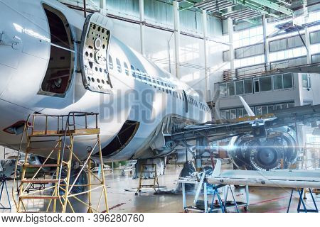 Passenger Jet Plane Under Maintenance In The Hangar. Checking Mechanical Systems For Flight Operatio