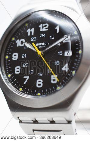 Geneve, Switzerland 07.10.2020 - Swatch Logo On Black Wristwatch Dial Of Swiss Made Mechanical Watch