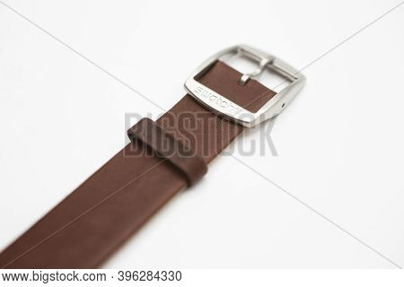 Rome, Italy 07.10.2020 - Swatch Logo On Brown Wrist Strap Of Swiss Made Quartz Watch Isolated On Whi