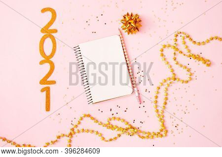 New Year Goal List 2021. Desk With Notebook For Writing About Plan Listing Of New Year Goals And Res