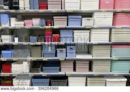 Shelves In The Store With Plastic Storage Boxes. Inexpensive Alternative To Subjects Made From Natur