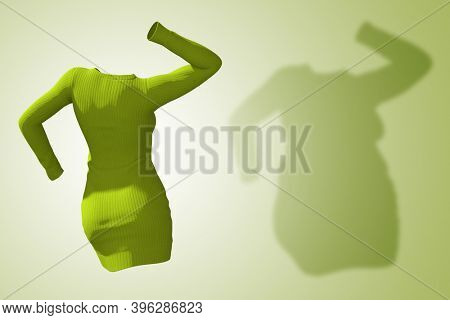 Conceptual fat overweight obese shadow female sweater dress vs slim fit healthy body after weight loss or diet thin young woman on green. A fitness, nutrition or obesity health shape 3D illustration