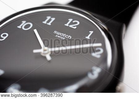 Geneve, Switzerland 07.10.2020 - Swatch Swiss Logo On Black Wristwatch Dial Of Swiss Made Mechanical