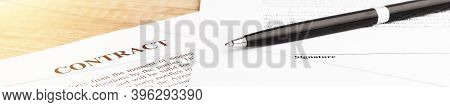 Legal Contract Signing - Buy Sell Real Estate Contract. Pen Lying On A Contract Or Application Form.