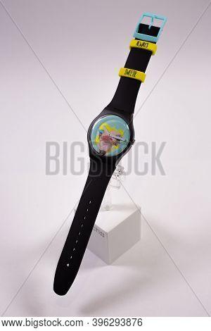 Geneve, Switzerland 07.10.2020 - Swatch Childrens Swiss Made Plastic Watch On Stand, Ostrich Head On