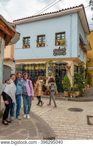 Ioannina, Greece - April 30, 2019: Happy Tourists Posing Near