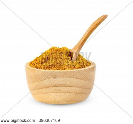 Dry Turmeric Powder Or Curcuma Longa Linn In Spoon And Wooden Bowl Isolated On White Background.