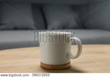 Hot Water In A White Cup On A Wooden Table