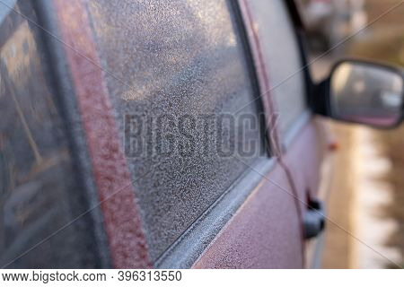 The Car Outside Has Been Frozen In The Frosty Morning. Picture Of The Frozen Car With The Windows Co