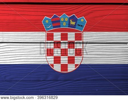 Flag Of Croatia On Wooden Wall Background. Grunge Croat Flag Texture, Red White And Blue With The Co