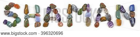 Shaman Word Created With Healing Crystals -  Different Coloured Polished Stones Arranged Neatly To R