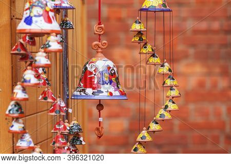 Colorful Ceramic Bells  Sold On Christmas Market In Europe. Bell Clay Souvenir Gift At The Fair. Sou