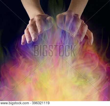 White Witch Sensing Ectoplasmic Activity - Female Hands Sensing A Gaseous Field Of Vibrant Colourful