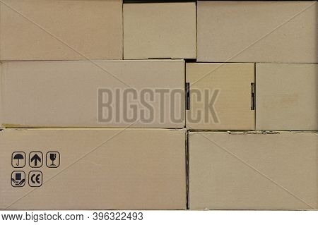Cardboard Boxes At The Post Office Close-up, Beige Backgroun, Background D