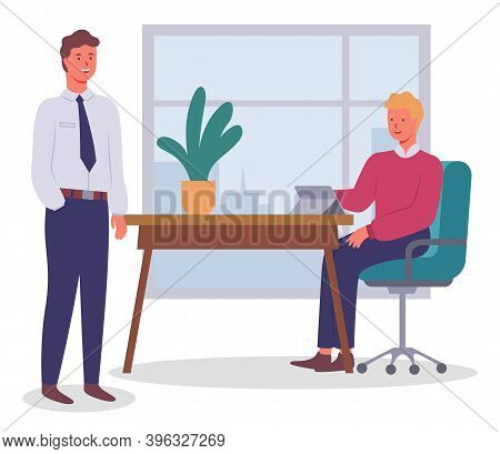 Office Workers. Colleagues Communicating. Executive Guy Wearing Office Suit Talking With Man Sitting