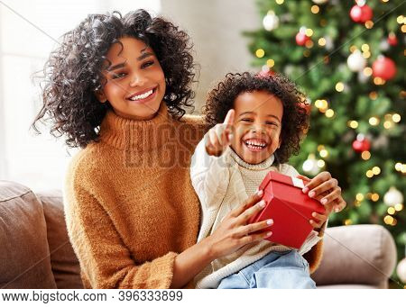 Happy  African American Family On Holiday: Cute Kid Boy And Mother Congratulate Each Other At Christ