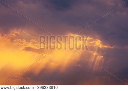 Sunshine In Sunrise Bright Dramatic Sky. Sun Ray Through Dark Rainy Clouds. Scenic Colorful Sky At D