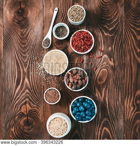Various Superfoods In Small Bowl On Wooden Table.selection Super Food.superfood As Blueberry, Chia,