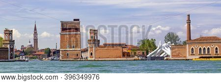 Venice Italy - May 25, 2019: Biennale Arte 2019 Sculpture Of Giant White Hands Called Building Bridg